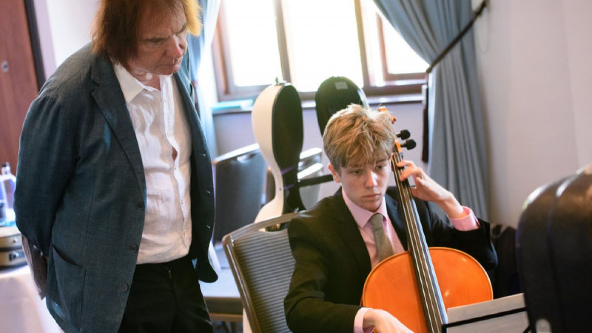 Professor Julian Lloyd Webber helping one of Lincolnshire's Cello students